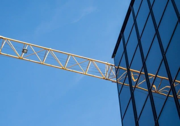 building with crane expert